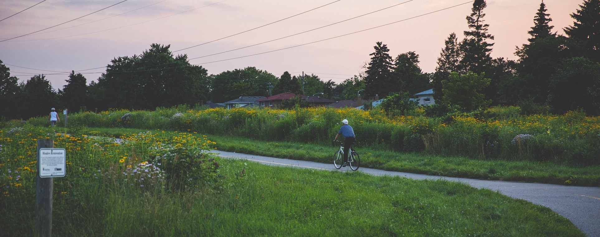 cyclist on Meadoway trail at sunset