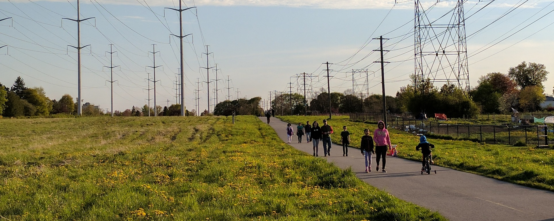 local residents walk hydro corridor trail at sunset