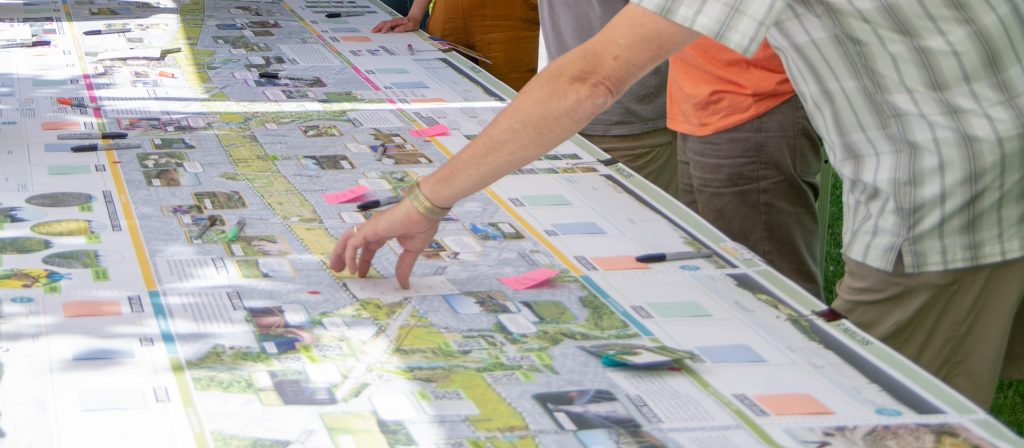 community members examine Meadoway map at public information centre