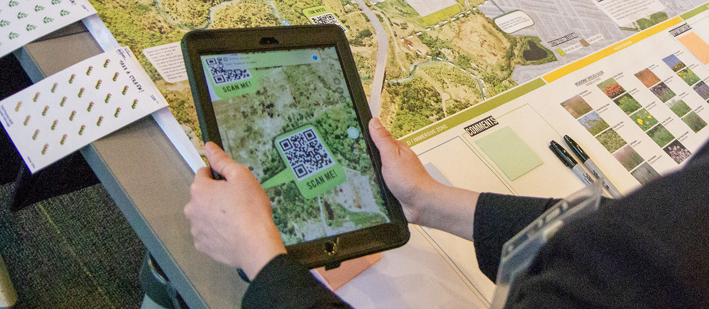 community member views Meadoway map using tablet