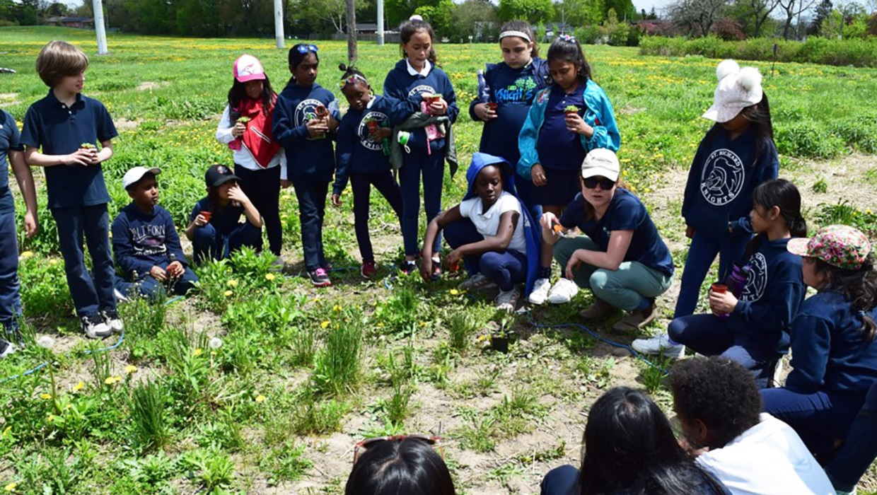 students participate in community planting event in The Meadoway