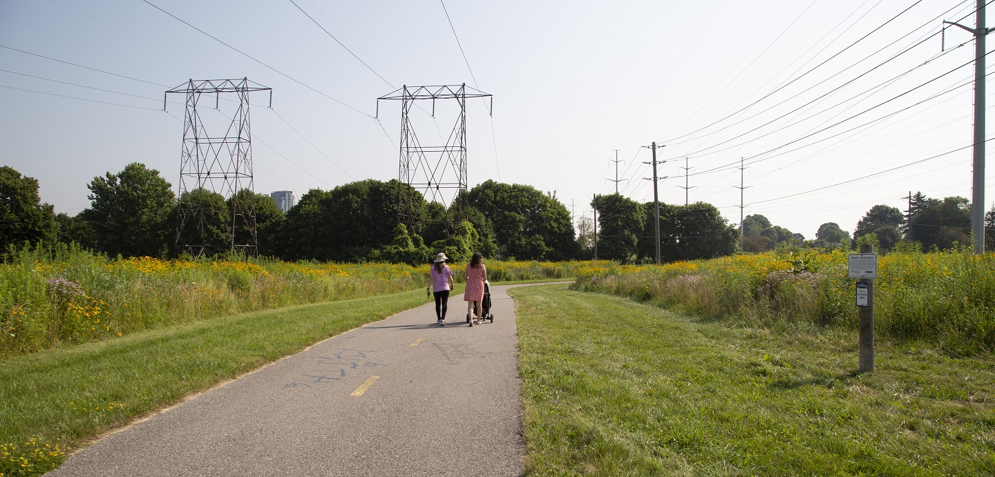 two women with stroller walk along Scarborough hydro corridor trail