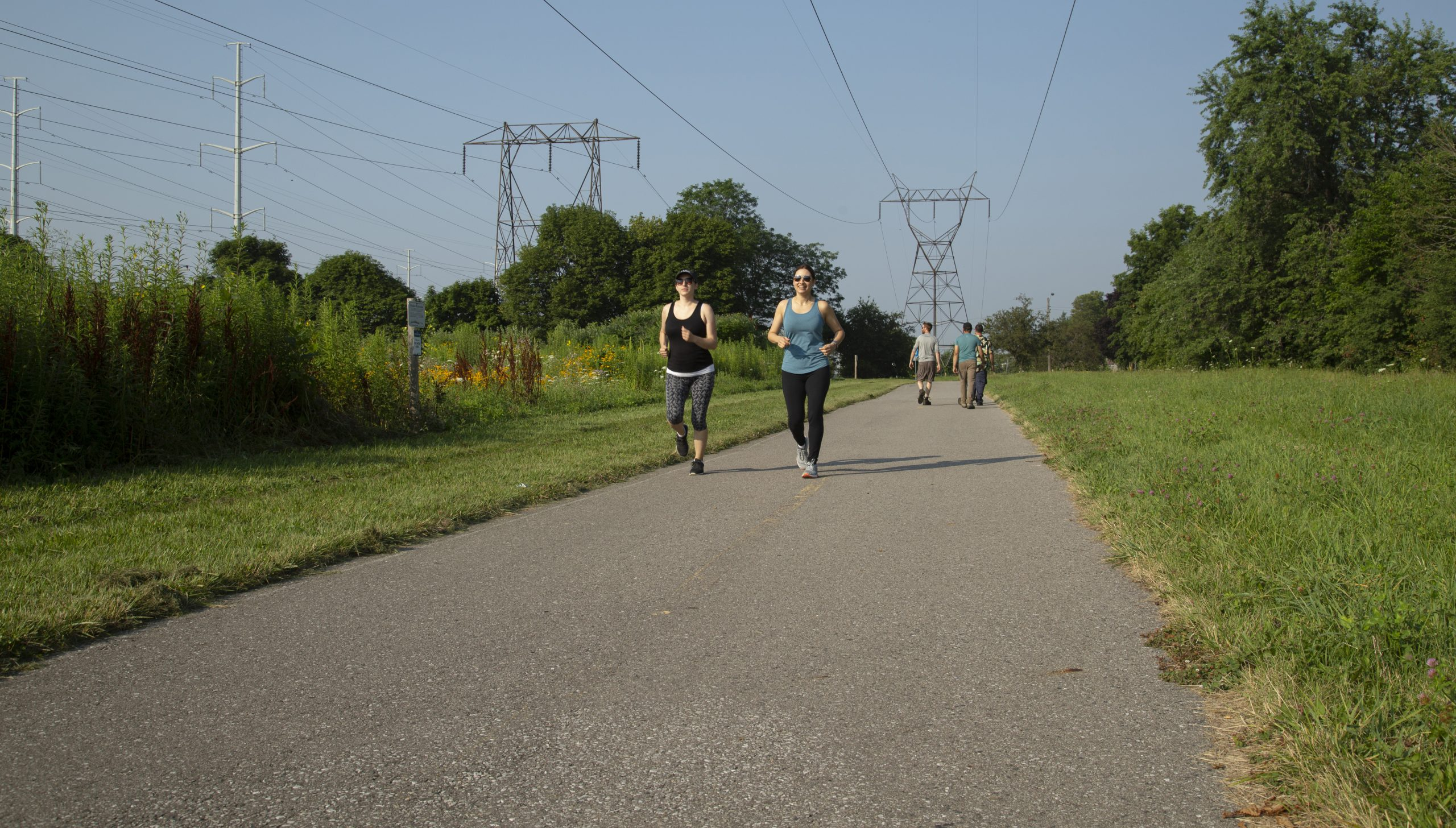 joggers and pedestrians on hydro corridor trail network in Scarborough