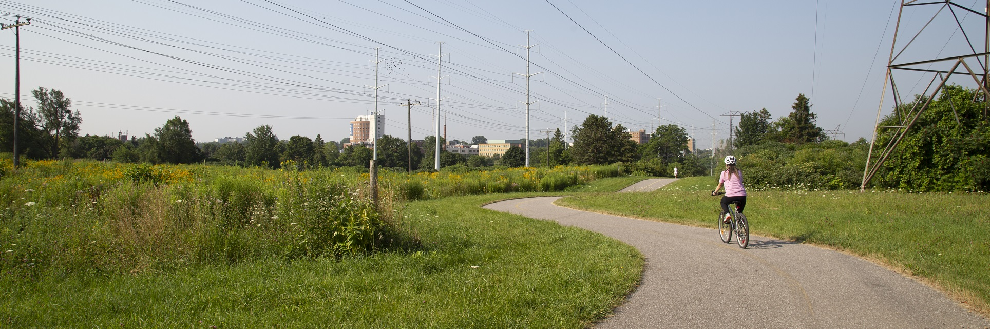 girl rides bicycle along hydro corridor trail in Scarborough