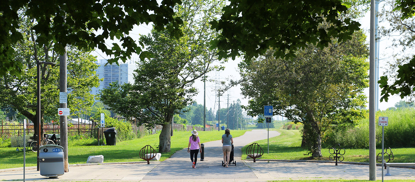 woman with stroller and friend explore hydro corridor trail network