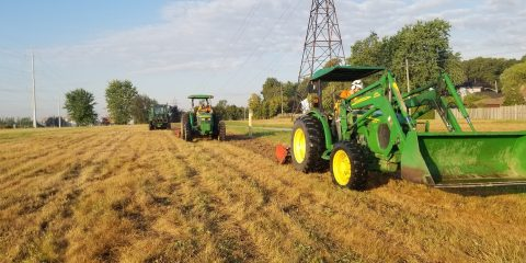 tractors break up turf in The Meadoway